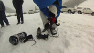 Stock Video Footage of Taking off ski boots and putting on shoes
