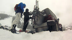 Time lapse of packing up skis and snowboard on Jeep Stock Footage
