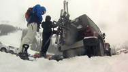 Stock Video Footage of Time lapse of packing up skis and snowboard on Jeep