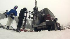 Packing up skis on back of Jeep Stock Footage