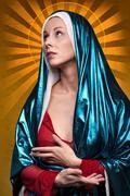Virgin Mary with sun rays - stock photo