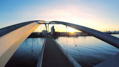 flying over bridge at sunset. modern futuristic architecture. blue hour - stock footage