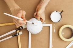 Painter painting a sphere, close-up - stock photo