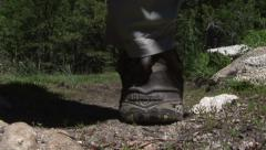 Hiker Steps Over Camera on trail Stock Footage