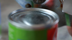 Using a can opener closeup Stock Footage