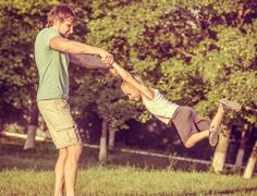 family father man and son boy playing outdoor happiness emotions lifestyle wi - stock photo