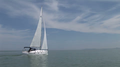 Sailing boat navigating with open sails - stock footage