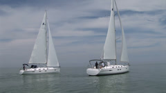 Sailing boats navigating with open sails - stock footage