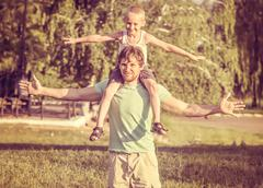 family father man and son boy sitting on shoulders outdoor happiness emotions - stock photo