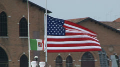 American and Italian flag waving on a boat in Venice Stock Footage