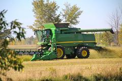 farm work scenery and machinery - stock photo