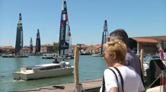 Tourists looking at America's cup boats docked in Venice Stock Footage