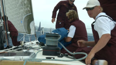 Crew of sailing boat maneuvering during regatta - stock footage