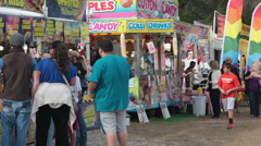 Carnival festival colorful food booths people HD 1976 Stock Footage