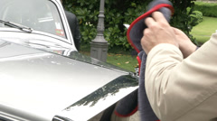 Man cleaning old classic car at the Concorso d'Eleganza at Villa d'Este Stock Footage