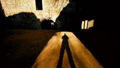 Silhouette of person. shadow. light and darkness. old castle ruin Stock Footage