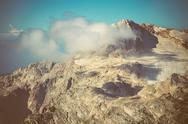Stock Photo of rocky mountains with clouds sky and glacier snow beautiful landscape caucasus