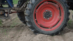 Follow tractor wheel seeder equipment sow buckwheat seeds Stock Footage