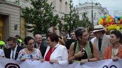 Gay parade representatives demanding equal rights posters Stock Footage