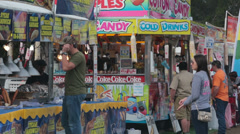 Carnival food booths colorful fun HD 1972 Stock Footage