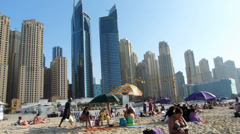 PAN Dubai Marina Public Beach Skyscrapers apartments real estate Property Crisis Stock Footage