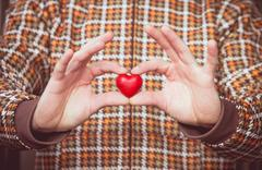 heart shape love symbol in man hands valentines day romantic greeting people  - stock photo