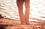 Stock Photo of foot man walking outdoor on beach trendy style melancholy concept