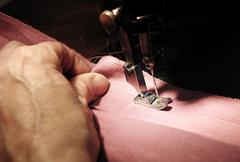 To sew a material on the sewing machine Stock Photos