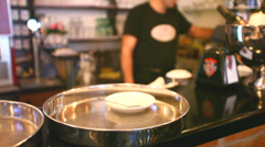 Waiter preparing coffee to be served Stock Footage