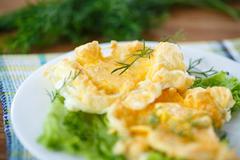 yolk baked into the beaten egg whites - stock photo