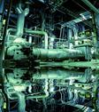 Stock Photo of Pipes, tubes, machinery and steam turbine at a power plant with