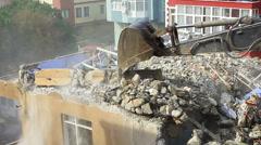 Crawler dozer turning homes into rubble Stock Footage