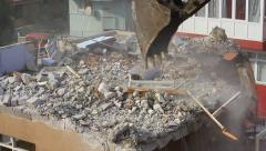 Using water sprays or sprinklers to keep the dust down during breaking concrete Stock Footage