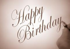 callligraphy happy birthday - stock photo