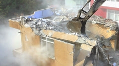 Digger using its bucket to demolish house. Time Lapse - stock footage