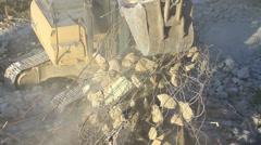 Excavator lifting up scrap rebars. Close up Stock Footage