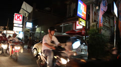 Nightlife scooter traffic in legian Stock Footage