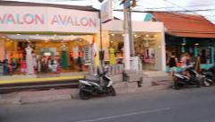 The stores and shops on a main road near Seminyak square Stock Footage