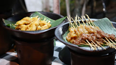 A look at some satay dishes at an outdoor indonesian style bbq Stock Footage