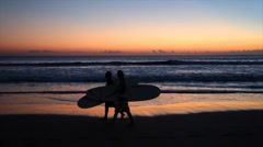 Silohette of surfer and some people enjoying the legian beach in Bali Stock Footage
