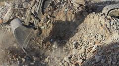 Crawler excavator bucket working on pile of debris Stock Footage