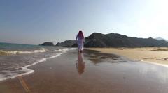 Arabian man,on the beach.Arab man walks along the sea Stock Footage