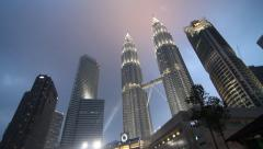 An evening tilt wide angle of the petronas towers Stock Footage
