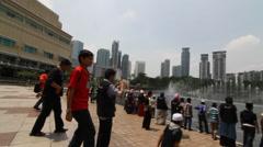 Petronas fountain pan shot in front of Petronas towers Stock Footage