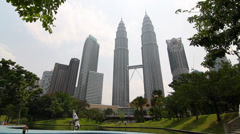 Wide shot of petronas towers from the center of the park Stock Footage
