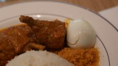 Delicious chicken nasi lemak curry Stock Footage
