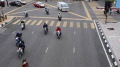A medium to wide shot of traffic waiting at a busy Kuala lumpur intersection Stock Footage