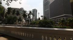 Shot of Kuala Lumpur tower from Jamek Mosque Stock Footage