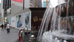A view in front of the popular Pavillion Mall fountain. Right Pan Stock Footage