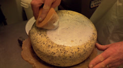 Stock Video Footage of Adding a plastic coating to a cheese [Slomo]